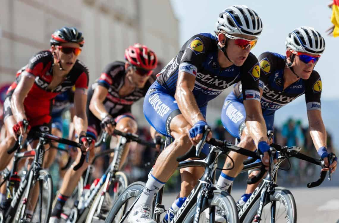 professional athletes riding a bicycle